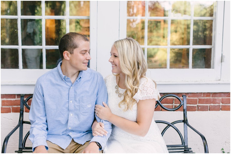 couple sitting on bench at longwood gardens engagement