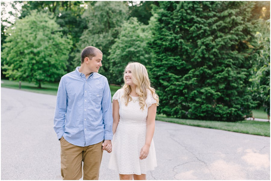 couple smiling and walking at longwood gardens