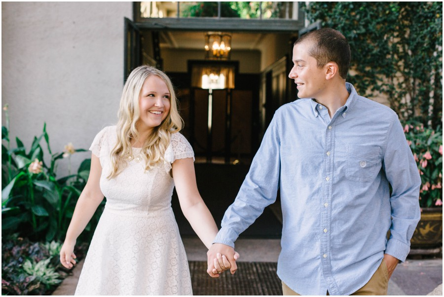 couple smiling and holding hands at longwood gardens