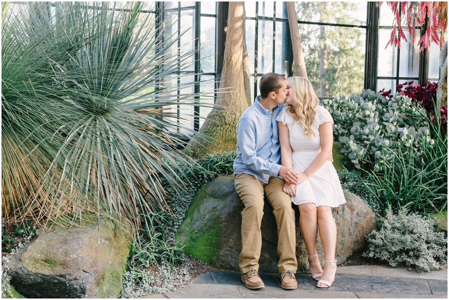 couple kissing on rock at longwood gardens