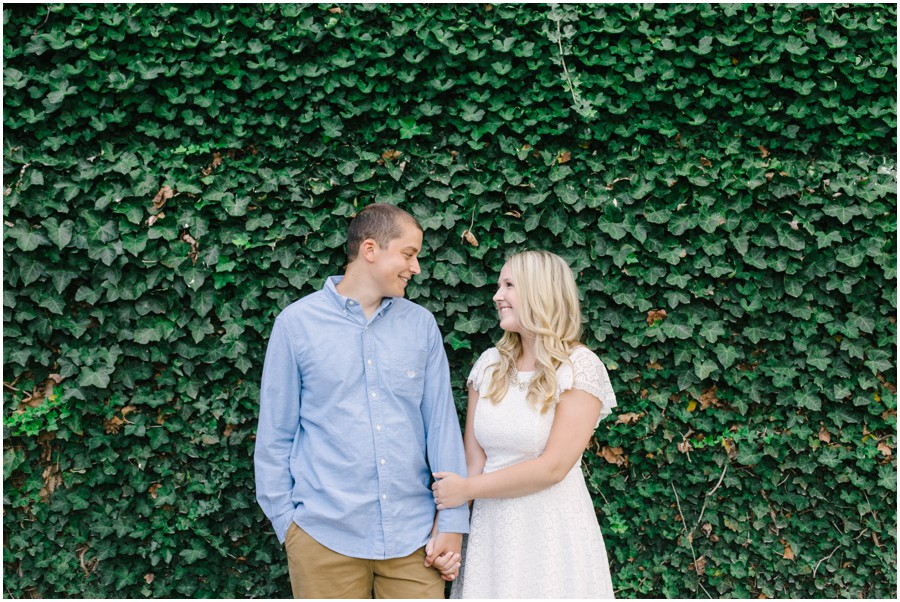 couple standing in front of vine wall at longwood gardens