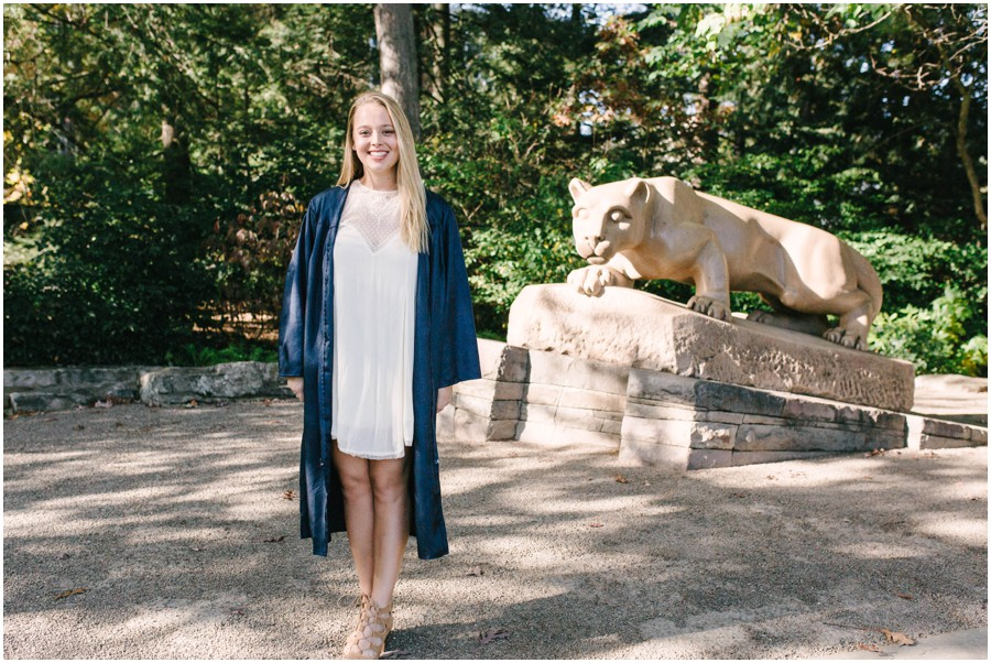 penn state graduate by nittany lion statue