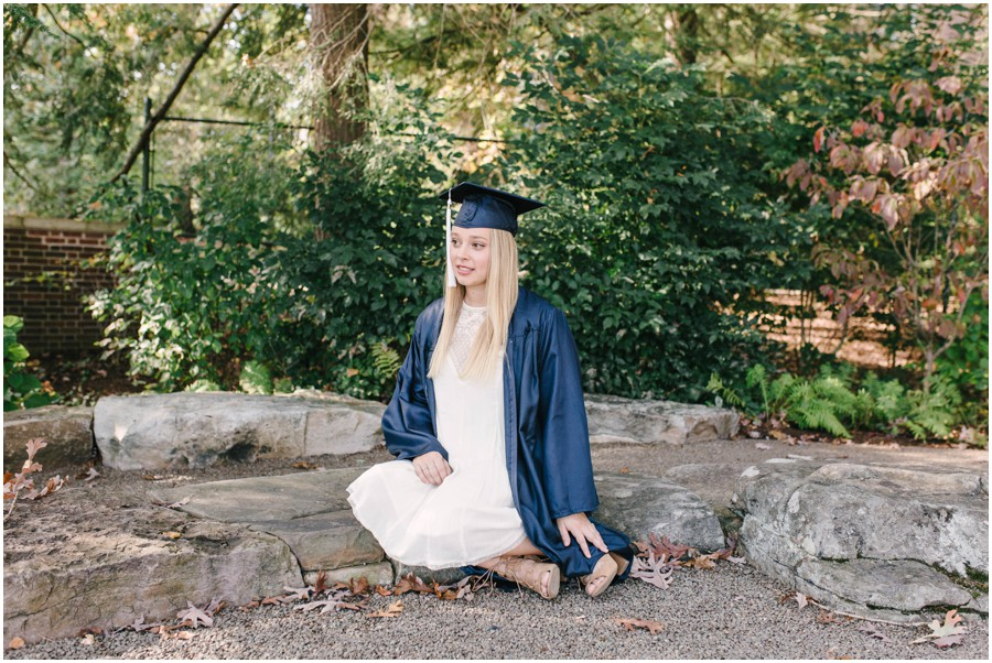 penn state senior sitting in gown looking away