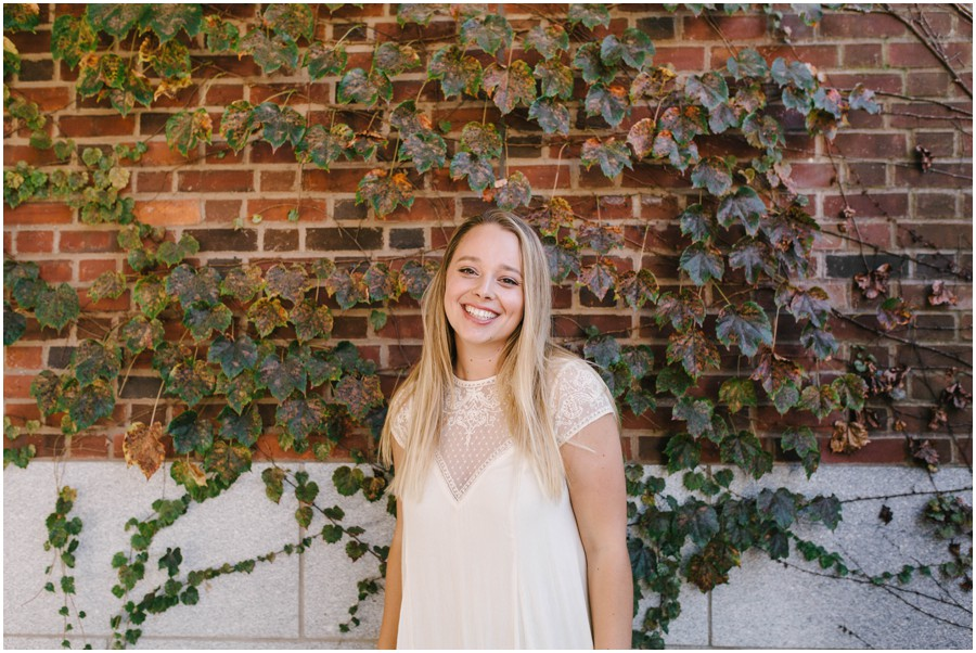 penn state graduate standing in front of vine wall