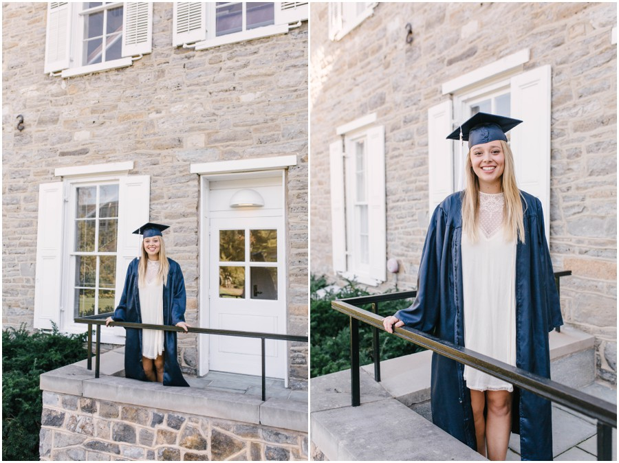 penn state senior in gown standing in front of building
