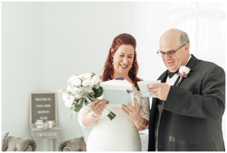 bride giving groom gift at loch aerie mansion