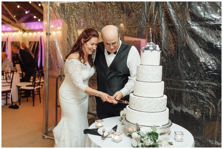 couple cutting masters baker cake at loch aerie mansion wedding frazer pa